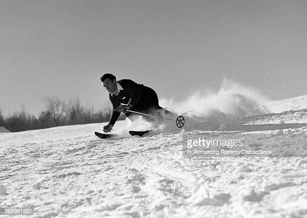 1940s MAN SKIING DOWNHILL...