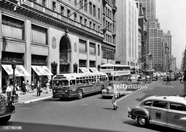 1940s Pedestrians Buses Cars Cabs 5Th Avenue Traffic Looking North Lord & Taylor Department Store Manhattan New York City Ny USA