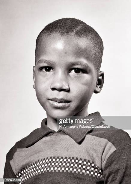 1940s Portrait African-American Boy Looking At Camera Serious Facial Expression