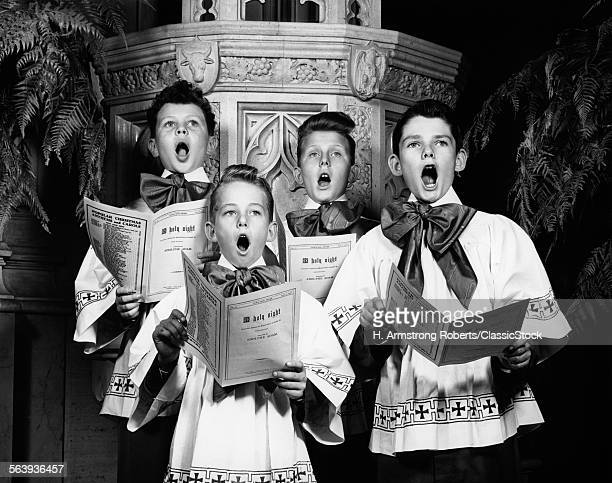 1940s PORTRAIT OF 4 CHOIRBOYS SINGING O HOLY NIGHT