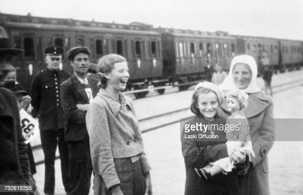 Resettlement of the Volksdeutsch population from Ukraine to Germanoccupied Poland circa 1942 A photo from an album documenting German atrocities in...