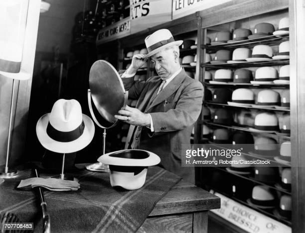 1940s SENIOR MAN TRYING ON...