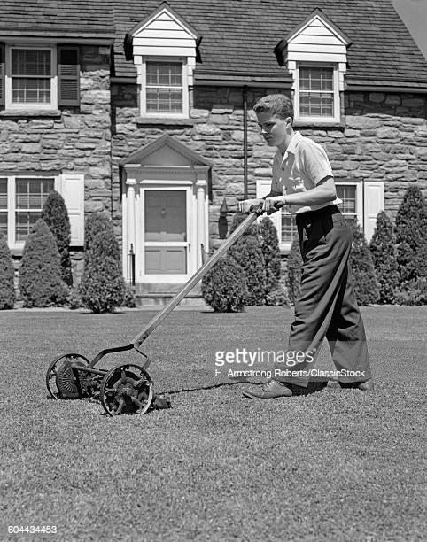 1940s TEENAGE BOY MOWING.