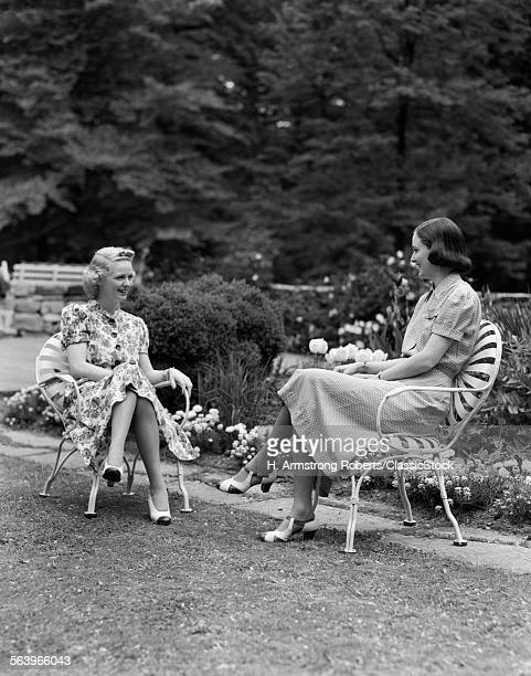 1940s TWO WOMEN SITTING IN...