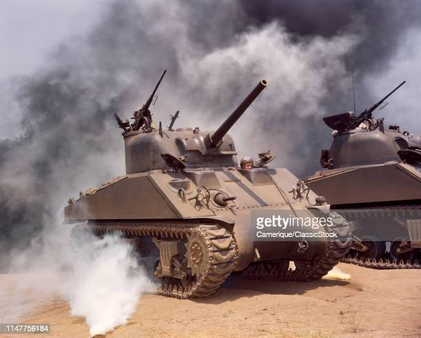 1940s TWO WORLD WAR 2 UNITED STATES ARMY SHERMAN M4 MEDIUM TANKS IN MIDST OF SMOKE COVER