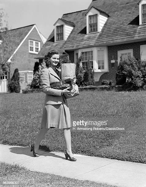 1940s WOMAN WALKING...