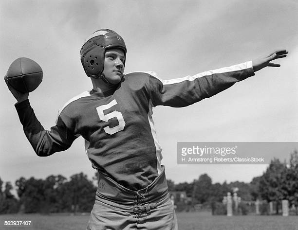 1940s YOUNG TEENAGE QUARTERBACK ABOUT TO TOSS FOOTBALL PASS