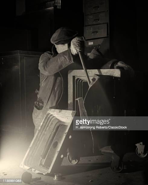 1940s CRIMINAL MAN WITH CROWBAR OPENING DOOR OF SAFE