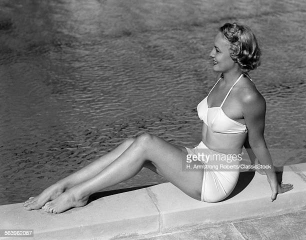 1940sLOND WOMAN SITTING...