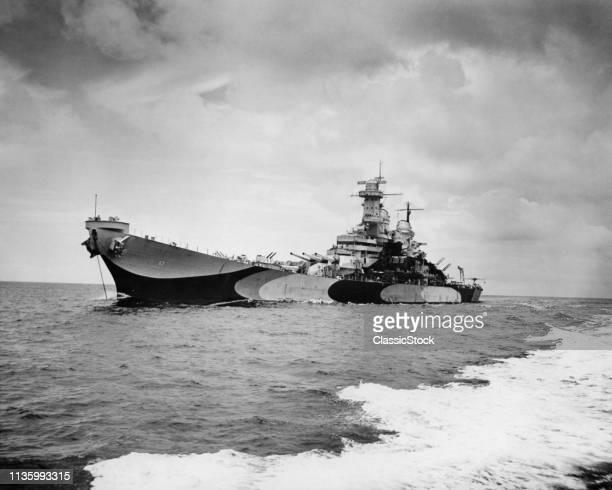 1940s USS MISSOURI BB-63 USN WORLD WAR II IOWA-CLASS BATTLESHIP AT SEA JUNE 1944 WEARING RAZZLE DAZZLE CAMOUFLAGE PAINT SCHEME