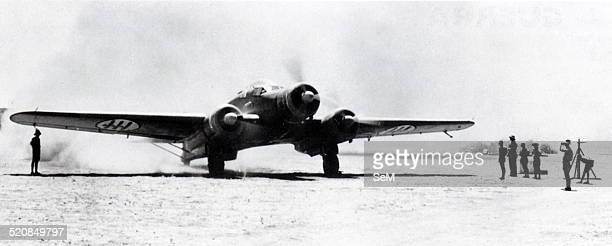 An italian medium bomber SM 79 ready to take off from an italian base in the libyan desert. The Savoia-Marchetti SM.79 Sparviero was a three-engined...