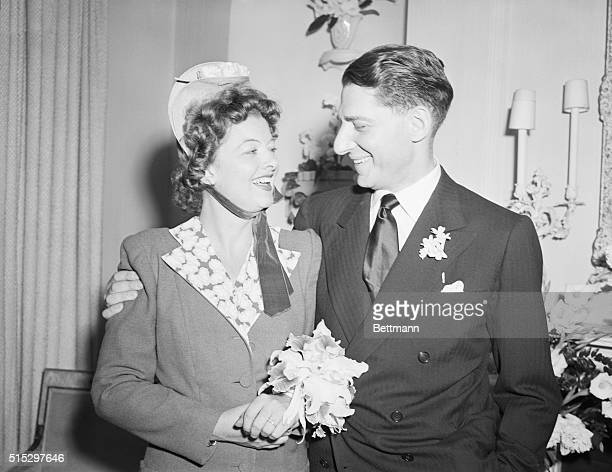 New York, NY- Myrna Loy, beautiful film star, pictured with her husband, John D. Hertz, Jr., after their surprise wedding last night, June 6. The...