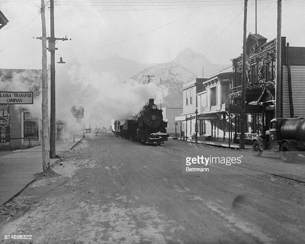 The engine and trains of the White Pass and Yukon railway line running through Broadway which is the only link between the Alcan highway and the...
