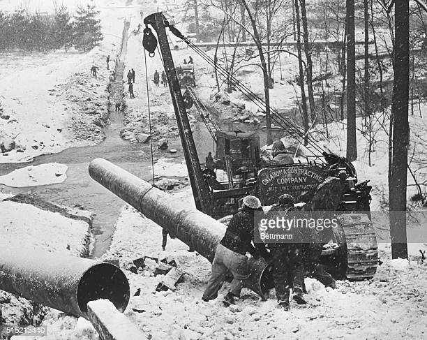 1943Glen Moore PA Pipeliners who are laying the 'Big Inch' oil line from Texas to New York and Pennsylvania are riding the butt end of a length of...