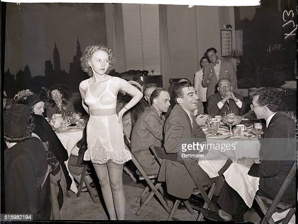 1947New York NYWith the exception of one woman the guests at a fashion luncheon in the New Yorker Hotel today seem to pay little attention to one of...