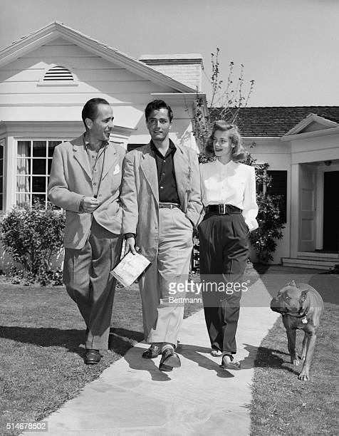 Hollywood, CA: Actor Humphrey Bogart and his wife, actress Lauren Bacall, are helping John Derek get a start in Hollywood. The young ex-paratrooper...