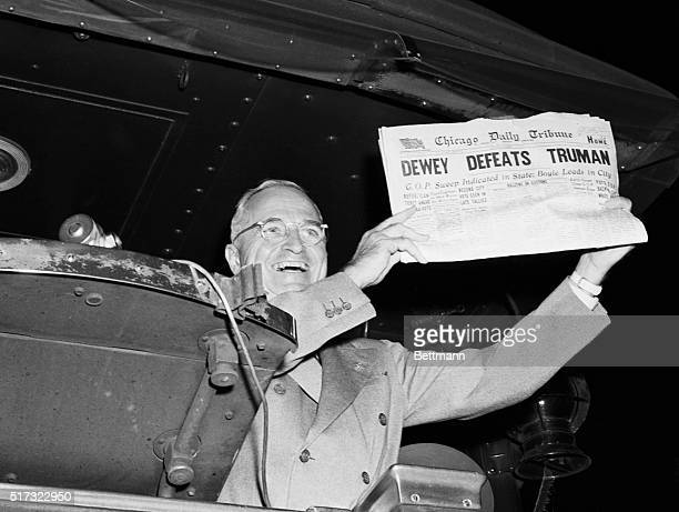 NOV 4 1948St Louis Mo This photo of President Harry S Truman laughing as he holds an early edition of the Chicago Tribune for Nov 4th was taken by...