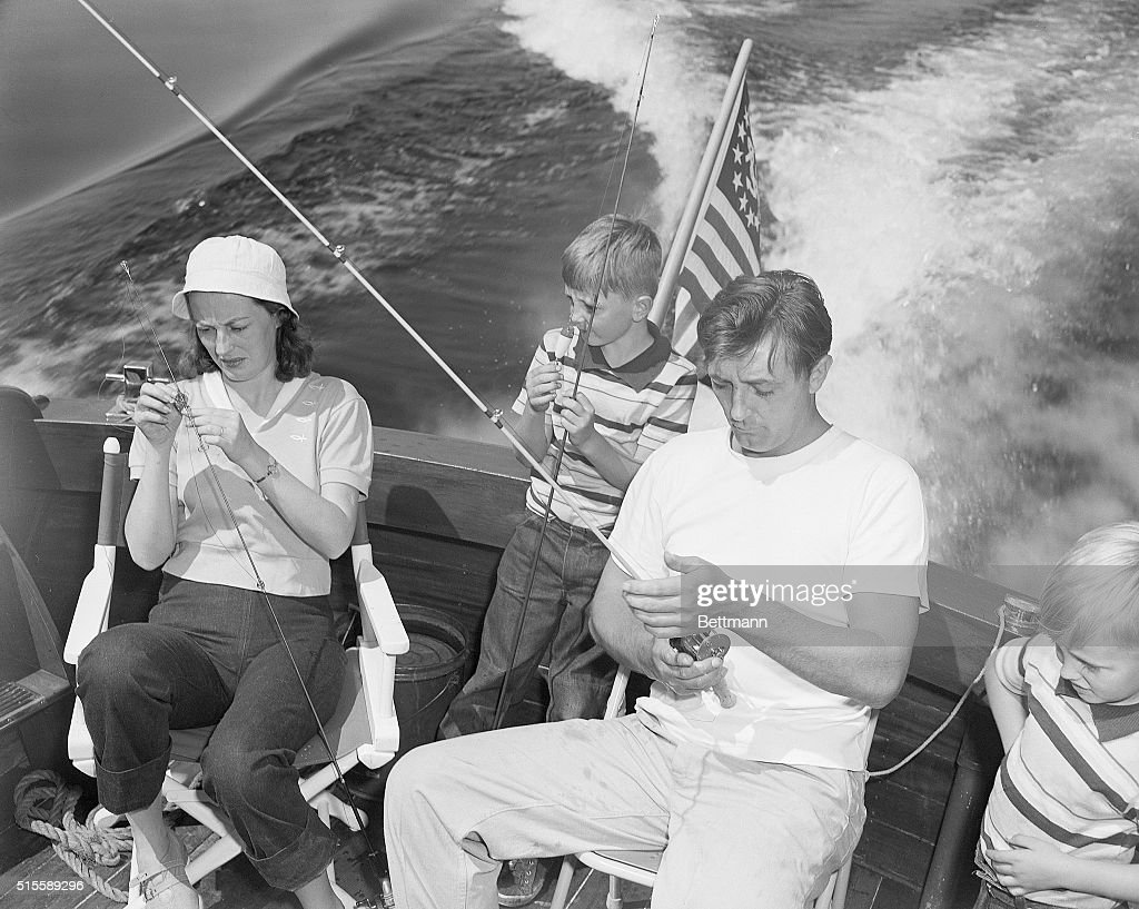 Robert Mitchum and Family Fishing on Lake Mead : News Photo