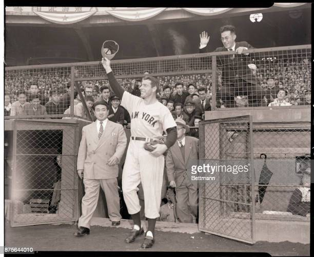 Joe DiMaggio is shown as he steps out of a dugout and tips his hat to his fans in the crowd