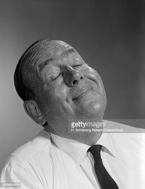 1950s 1960s HAPPY BALDING MAN WITH EXPRESSION OF SATISFACTION AND EYES CLOSED SMILING