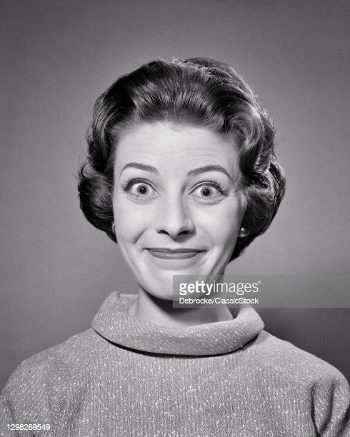1950s 1960s Portrait Brunette Woman With Bug-Eyed Smiling Silly Facial Expression Looking At Camera.