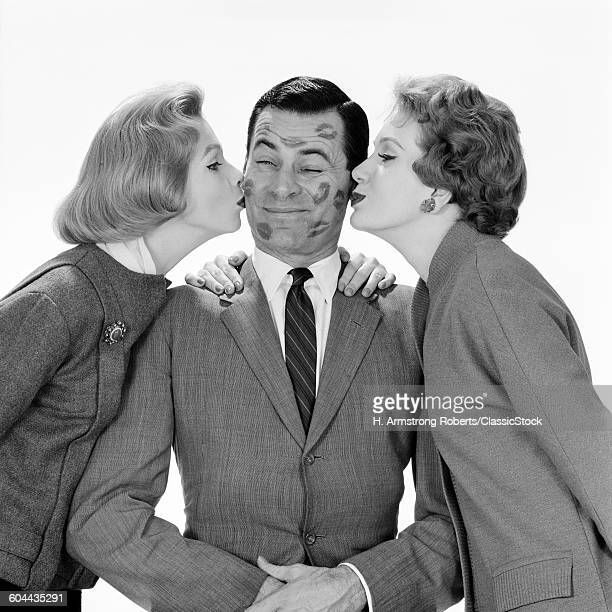 1950s 1960s SINGLE MAN BEING KISSED BY TWO WOMEN