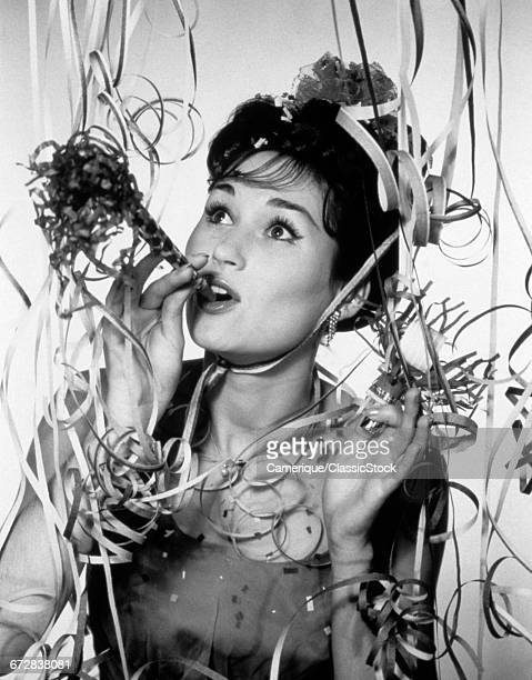 1950s 1960s WOMAN BLOWING...