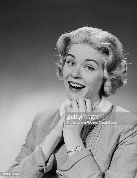 1950s 1960s WOMAN CLASPED HAND BY CHIN WITH WISHFUL HOPING HAPPY JOYFUL FACIAL EXPRESSION