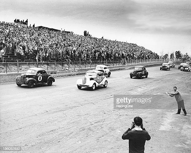 Action from an early 1950s NASCAR Modified race at Greensboro Fairgrounds Jimmy Lewallen was driving car No 0 while the No 70 was driven by Buck Baker