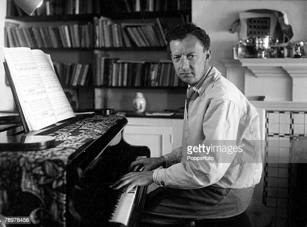 1950s Aldeburgh Suffolk A picture of British pianist composer and conductor Benjamin Britten sitting at the piano