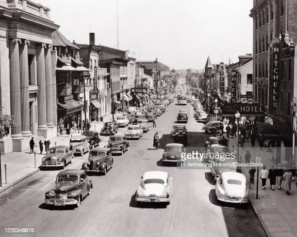 1950s AUTOMOBILES AND PEDESTRIANS ON BUSY COMMERCIAL MAIN STREET IN NORRISTOWN PENNSYLVANIA USA