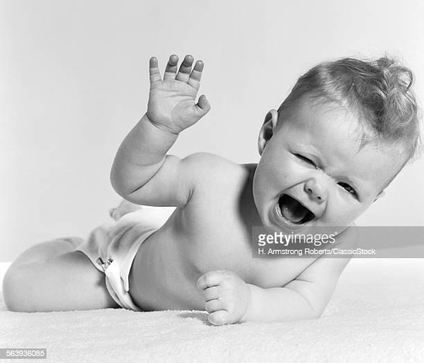 1950s BABY LYING ON...