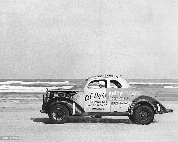 Billy Carden of Mableton GA drives at speed up the beach portion of the Daytona Beach Road course during a 1950s NASCAR Modified/Sportsman race