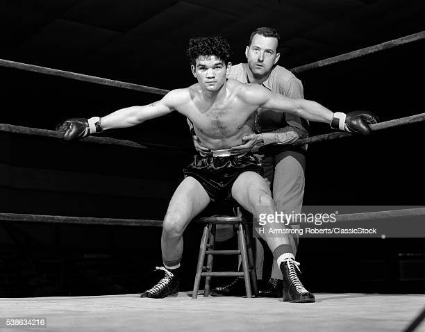 1950s BOXER IN RING WITH...
