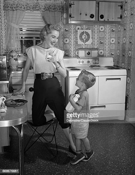 1950s BOY IN KITCHEN...