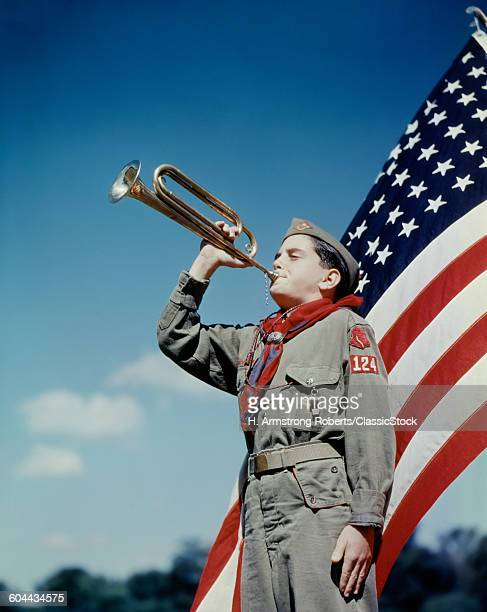 1950s BOY SCOUT BLOWING.