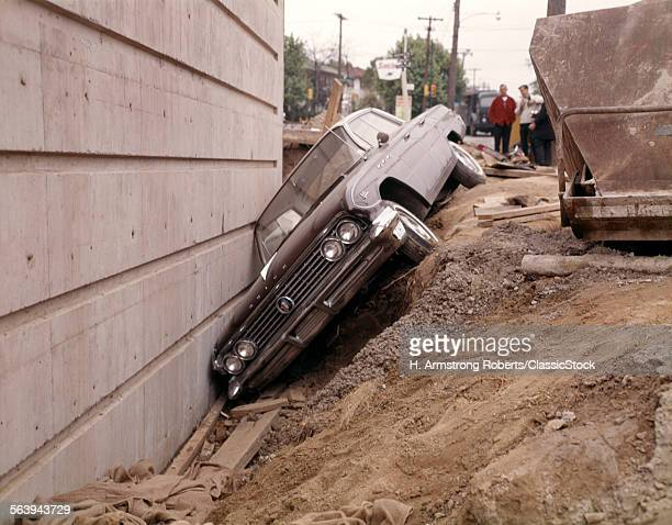 1950s BUICK CAR IN DITCH AGAINST CONCRETE WALL ACCIDENT