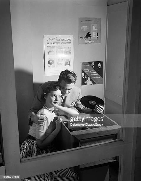 1950s COUPLE SITTING IN...