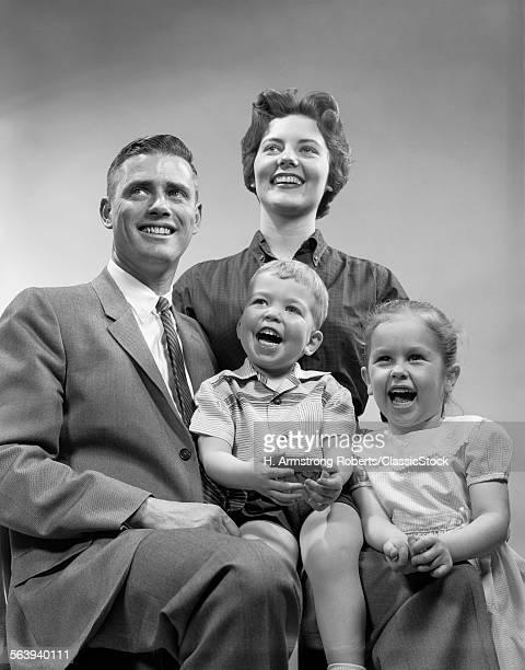 1950s FAMILY SMILING...