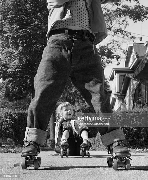 1950s GIRL FALLEN SITTING...