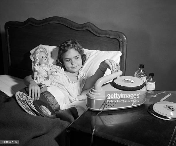 1950s GIRL SICK IN BED...