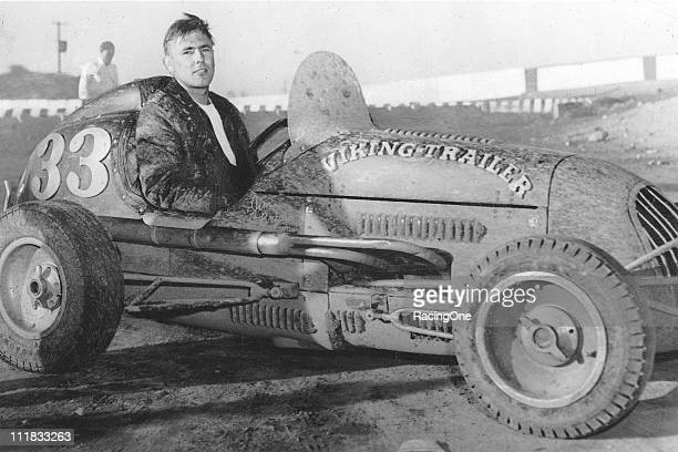 Jimmy Bryan with one of his USAC Midget rides in the mid1950s Bryan dominated the yearly ÒHoosier HundredÓ USAC Indy Car race at the Indiana State...