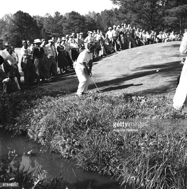 Jimmy Demaret pitches to the green during a 1950s Masters Tournament at Augusta National Golf Club in Augusta Georgia