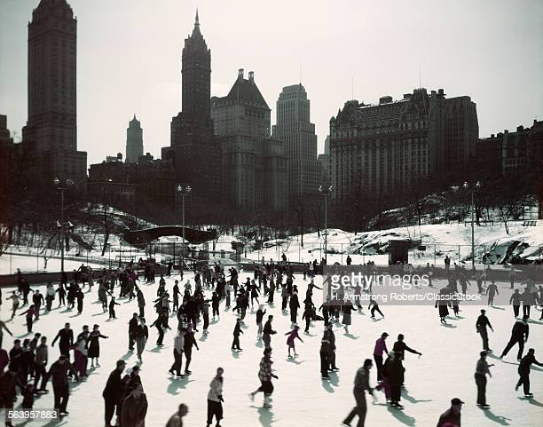 1950s LARGE NUMBER OF PEOPLE ICE SKATING ON WOLLMAN RINK CENTRAL PARK MANHATTAN NEW YORK CITY USA