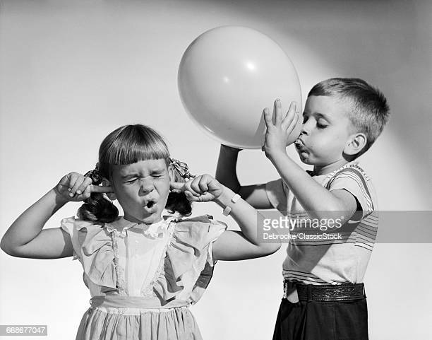 1950s LITTLE BOY BLOWING...
