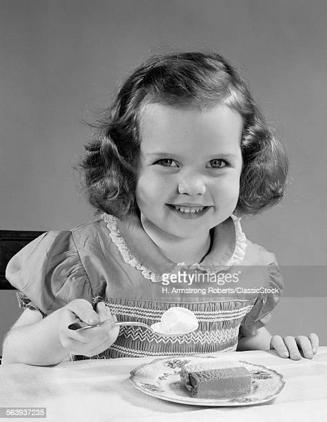 1950s LITTLE GIRL EATING...