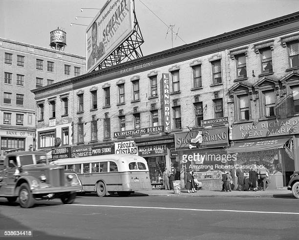 1950s MAIN STREET FLUSHING LONG ISLAND QUEENS STORE FRONTS BUS SHOPPERS NEW YORK CITY NY USA