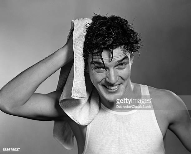 1950s MAN DRYING HAIR...