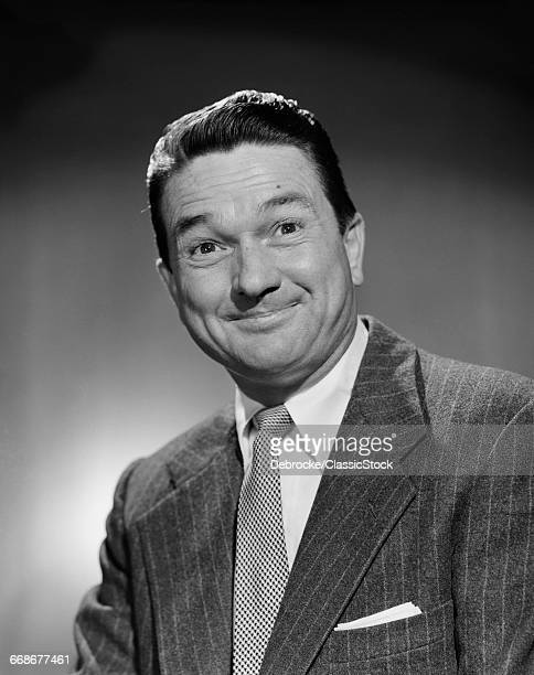 1950s MAN IN BUSINESS SUIT SMILING LOOKING AT CAMERA