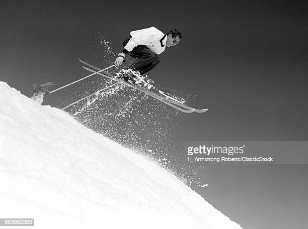 1950s MAN SKIER SKIING...
